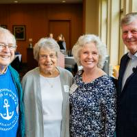 President Tom and Marica Haas posing with guests at the Retiree Reception.